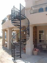 standard exterior steel spiral stair with expanded metal treads featuring belly style deck railing with hammered top and bottom railing painted black