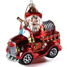 glass santa in firetruck ornament fighter