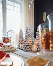 white and gold holiday tablescape with a twist