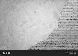 white brickwork underneath concrete wall textured suface half