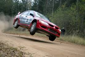 mitsubishi rally car mitsubishi lancer jumping rally vehicles racing mitsubishi