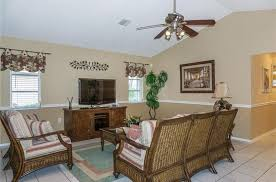 traditional living room with ceiling fan u0026 flush light in venice