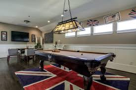 billiards rug family room traditional with union jack tan walls