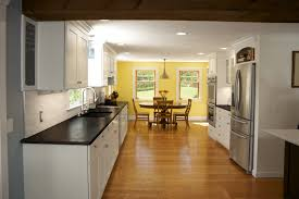 wonderful white open floor kitchen and yellow dining room with