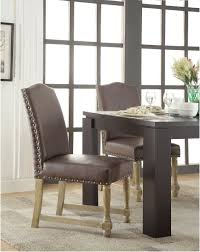 kingman dining chair with antique bronze nailheads and brushed