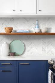white kitchen cabinets with blue tiles contemporary kitchen blue cabinets white marble backsplash