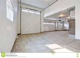interior of large three car garage in a brand new house stock