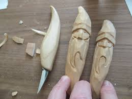 santa ornaments attempt at wood carving by kirk lewellen