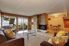 basement living room with fireplace and walkout patio u2014 stock