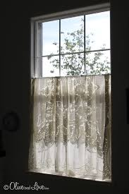 Half Window Curtains Oliveandlove Com Tablecloth Folded In Half Over A Tension Rod