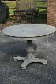 shabby chic wooden circled gray dining table with pedestal base