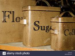 a set of antique tin kitchen canisters for flour sugar and coffee