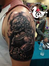 black hair foo dog tattoo on chest photo 3 photo pictures and