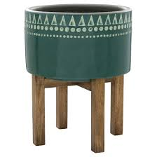add your favorite greenery to the earthenware wood base planter in
