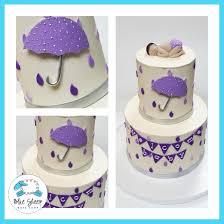 lavender baby shower buttercream lavender raindrops and umbrellas baby shower cake