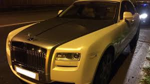 roll royce brown driver of garish gold rolls royce caught with no insurance