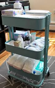 use an ikea raskog cart to organize diaper supplies in baby u0027s