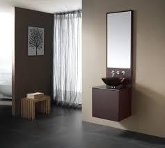 bathroom simple dark brown vanity with round glass bowl