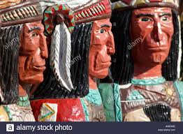 statues of native american indians carved from wood and painted
