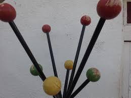 black iron coat rack vintage colorful wooden balls hat hanger at