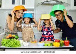 happy asian family show vegetable hand stock photo 705962983