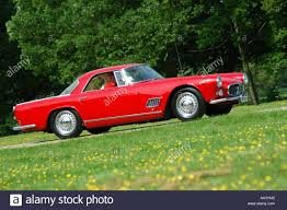 red maserati sedan red maserati 3500gt 1960 sports car stock photo royalty free