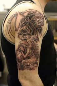 black ink grim reaper with angel and banner tattoo on man right