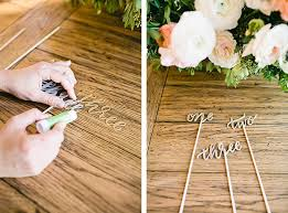 table numbers with pictures wedding bells diy table numbers lauren conrad