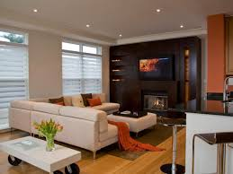 living room tv wall unit designs with white leather loveseat