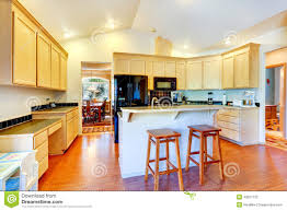 ivory kitchen cabinets with black appliances stock photo image