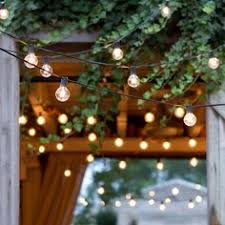 Backyard String Lighting by I Love This Look Of Lights Over The Deck She Gives Directions On