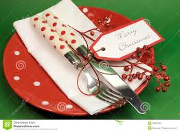 red and green merry christmas dinner table place setting stock