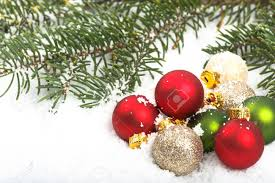 colorful red and green christmas ornaments in the snow with pine