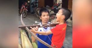 3rd World Kid Meme - kid removes tooth with crossbow