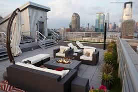 contemporary nyc rooftop deck with lawn fire pit and city view