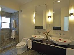 small oval bathroom mirror without frame applid above