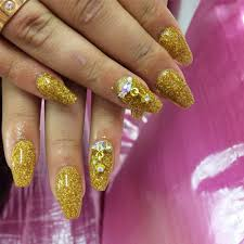 24k gold glitter coffin shaped acrylic nails with 3d swarovski