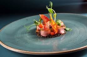 edible blood marinated duck breast blood orange edible clay pea sprouts