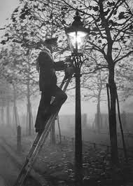 Sheryl Stringer by A Lamp Lighter Relighting A Gas Lamp In The Fog On November 17