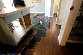 Laminate Flooring With Quarter Round Why We Didn U0027t Diy Our Kitchen Floors U0026 How To Save Money On Lowe U0027s