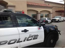 police man walks into target grabs knife from kitchen aisle