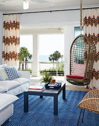 blue living room rugs white and blue living room with rope hanging chair transitional
