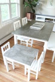 most durable dining table top parsons concrete top elm base dining tables crate and barrel