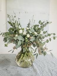 ranunculus bouquet simple white ranunculus eucalyptus bouquet emily alder