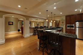 Laminate Flooring For Basement Spacious Cool Basement Ideas With Dark Stools And Long Teak Bar