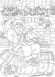 santa claus drinking tea with cookie while soaking up in front of