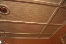 cover popcorn ceiling with beadboard then we put up small 1