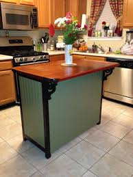 gray wooden kitchen island with black frame and brown wooden
