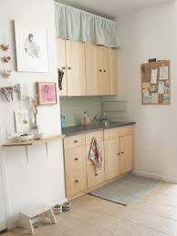 kitchen cabinet top storage 14 ideas for decorating space above kitchen cabinets how
