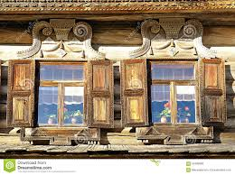 windows of wooden russian house built in traditional russian